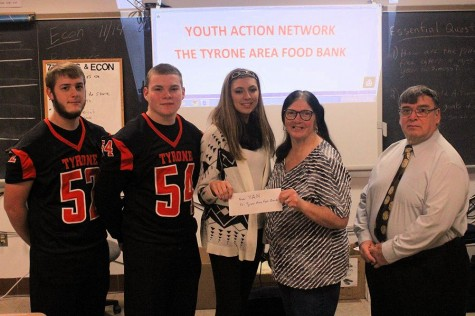 TAHS YAN club presents check to Tyrone Food Bank
