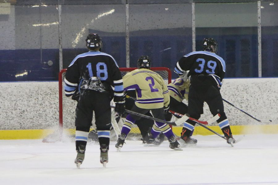 Tyrone's Zac Zamison (2) and Tyrone senior Trent Bogert with the save. (file photo)