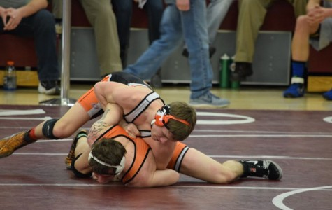Wrestling Districts – Junior Sage Dixon places fifth and moves on to regionals; Brown places sixth