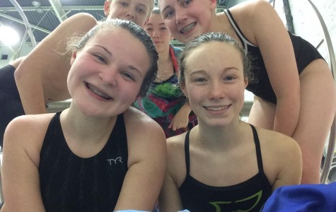 TAES & TAMS Swimmers Excel at YMCA Districts; Tyrone's Coleman Brings Home Gold