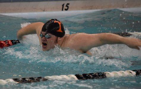 Swim Season Opens With a Double Win