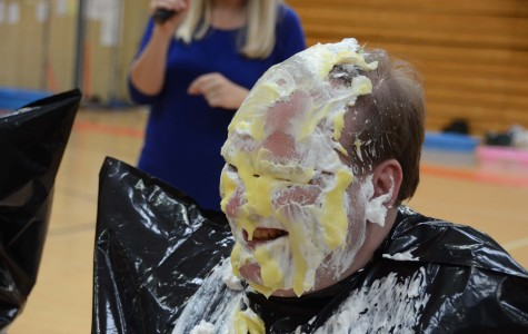 "Tyrone staffers get ""pied"" for charity"