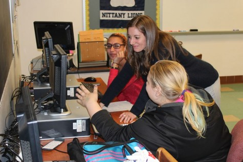 Markel works with TAHS students Shelby Gantt (left) and Shania Adkins.