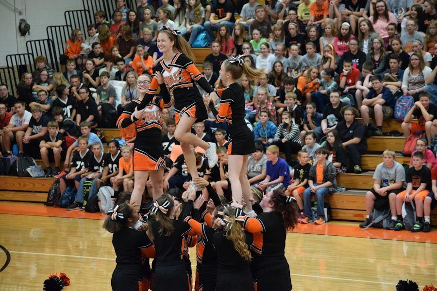 The Varsity cheerleading squad doing their stunts.
