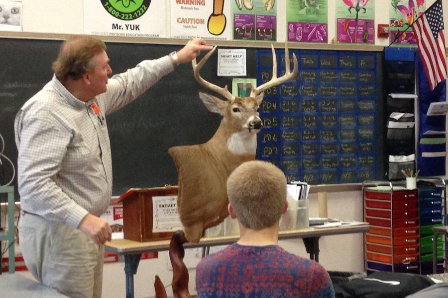 John Czerniakowski of Seven Mountains Taxidermy shows aspects of the Iowa Whitetail Deer he mounted for competition
