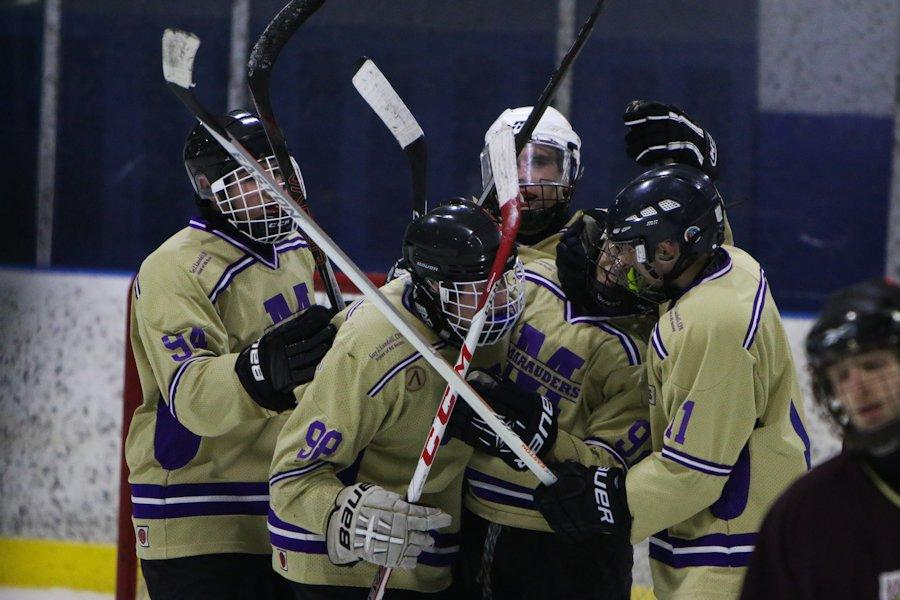 Tyrone players Nick Bonsell (middle), Dalton Berry (#92) and Zac Jamison (#2) celebrate a BG goal