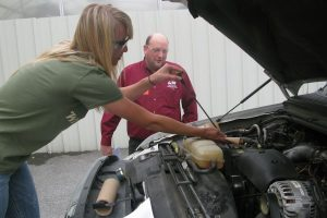 Carly Crofcheck Servicing an engine during the Production Ag practicum.