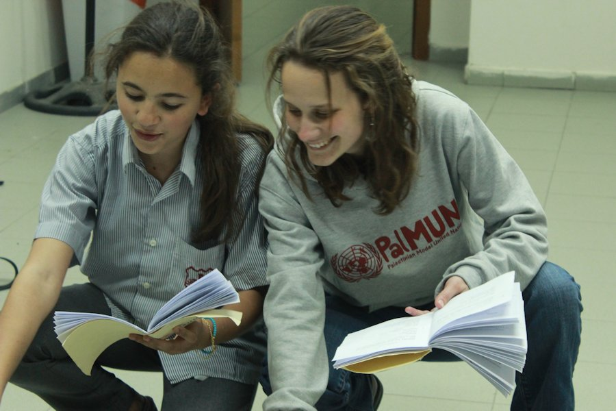 Grugan directing a play with her Palestinian students in 2015.