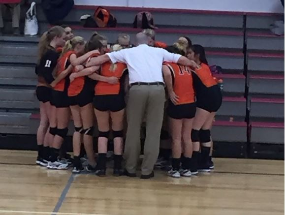 Girls huddle after a big win
