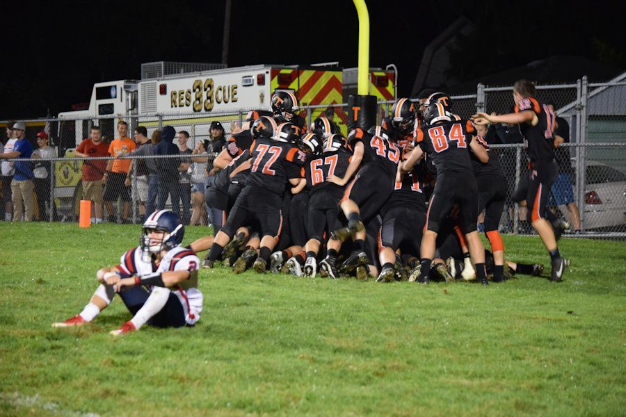 Tyrone players pile on Brandon Loose following his game winning overtime touchdown against Huntingdon.