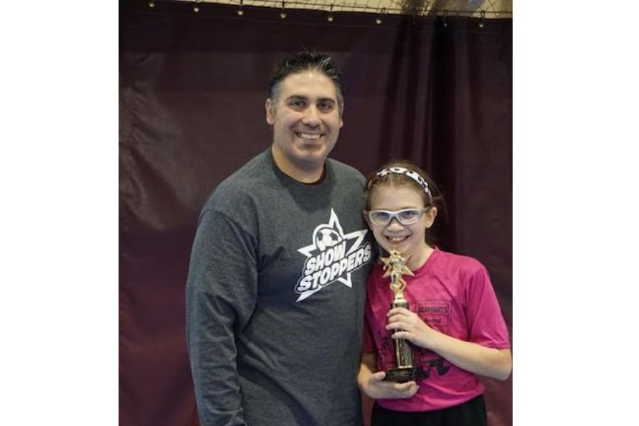 Coach Sparacino and his daughter at a recent indoor tournament.