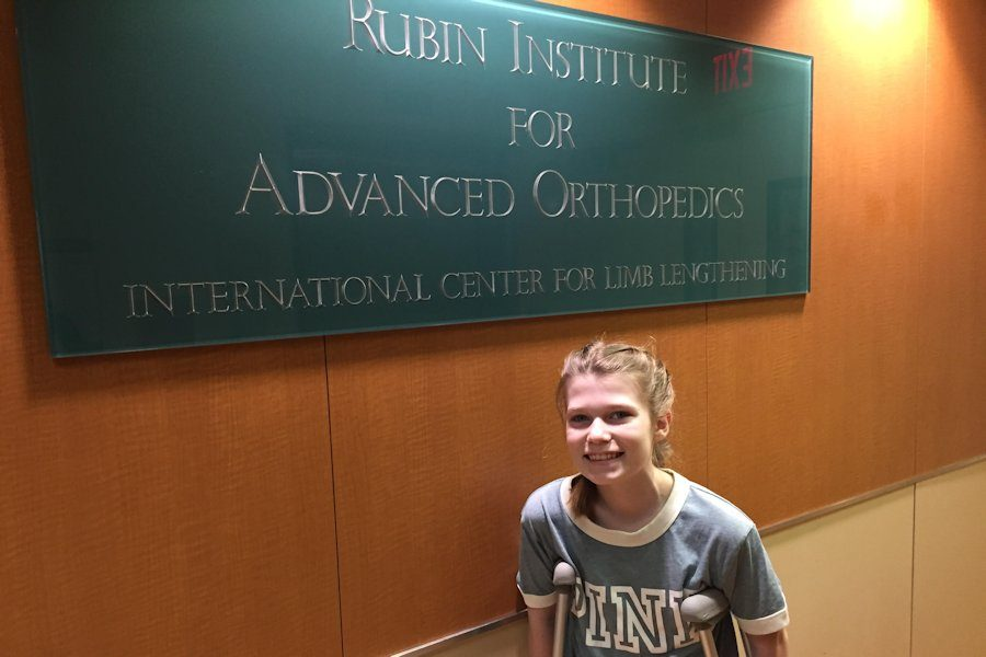Katie+in+front+of+the+Rubin+Institute+of+Advanced+Orthopedics+sign+in+the+waiting+room+for+Dr.+Herzenberg