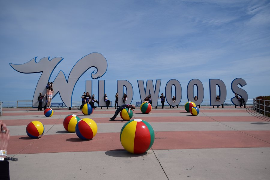 A group photo taken at the Wildwood sign
