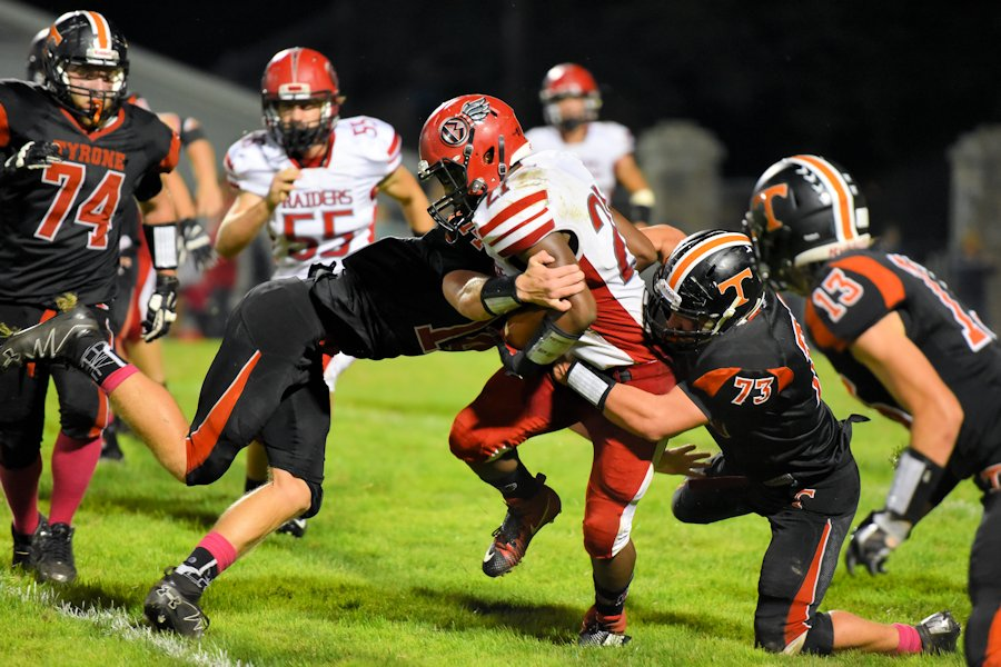 A hoard of Eagles making a tackle vs. Bellefonte last season.