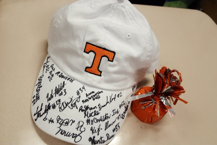 The cap that is signed by the seniors of the football team