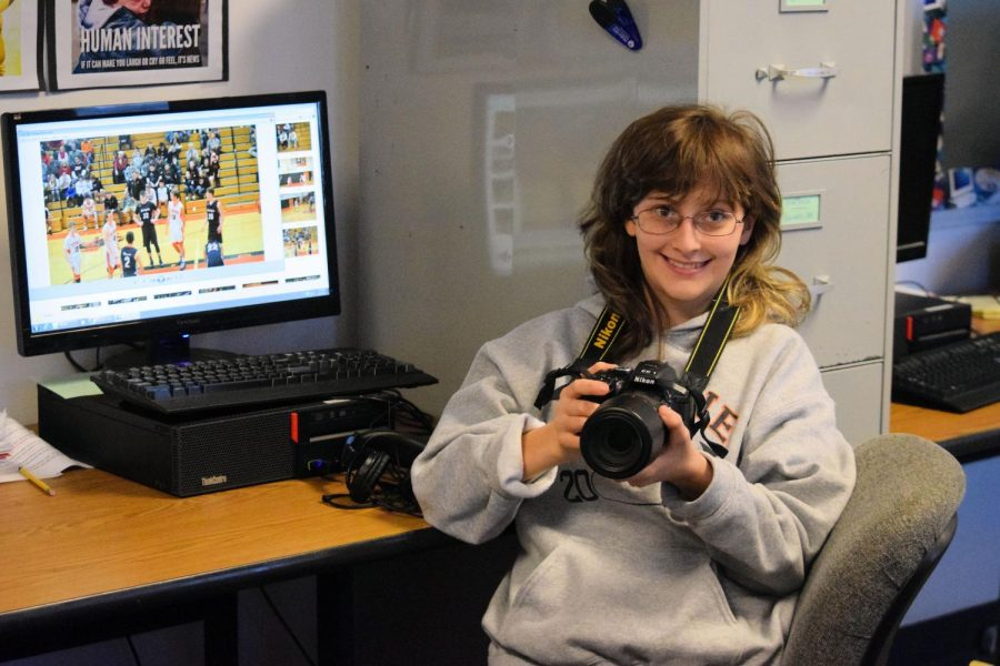Bev+at+her+Eagle+Eye+workstation+editing+photos+she+took+at+a+recent+boys+basketball+game.