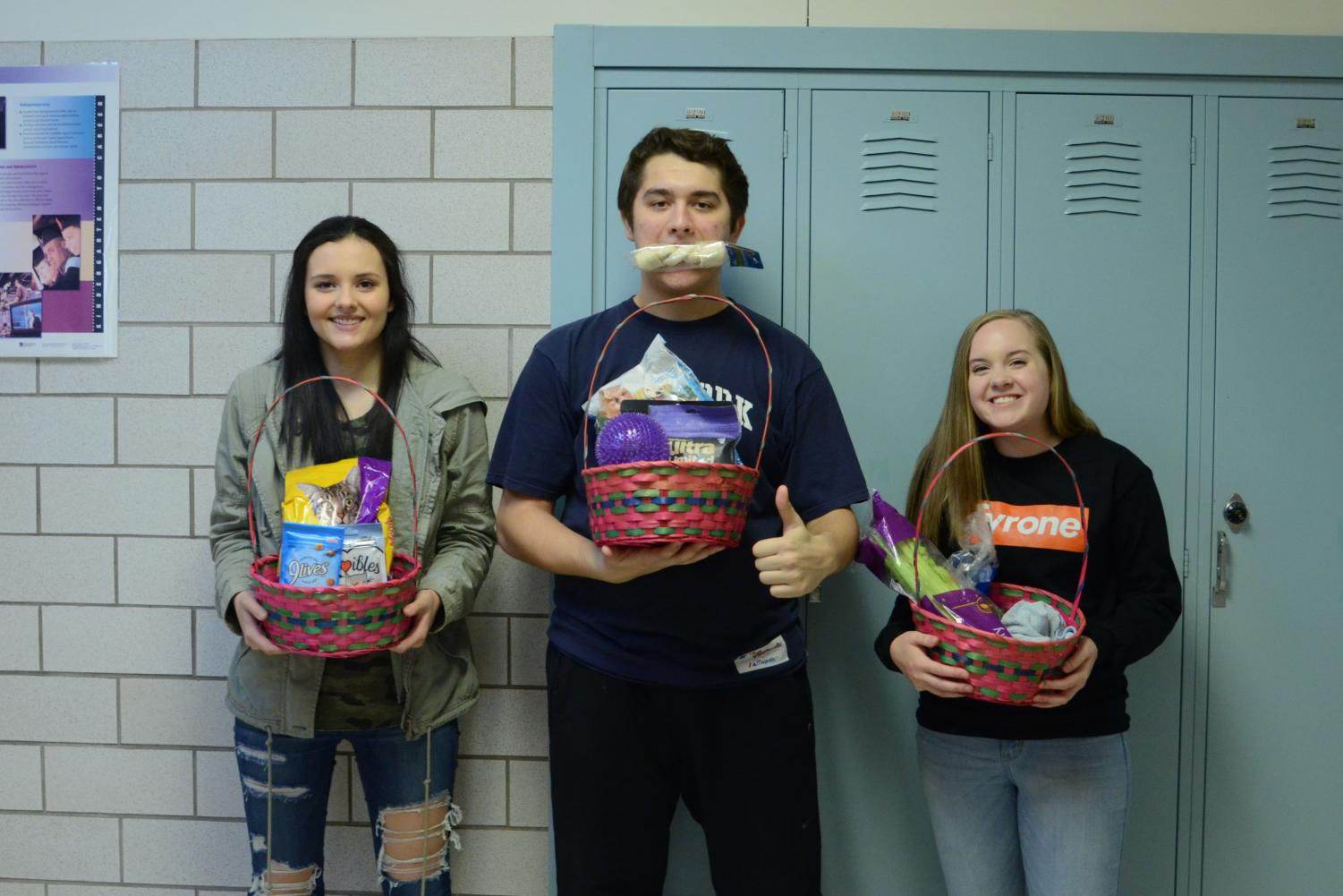 Last years winners with their prize baskets: Paige Hunter, Asher Christine , and Logan Johnston