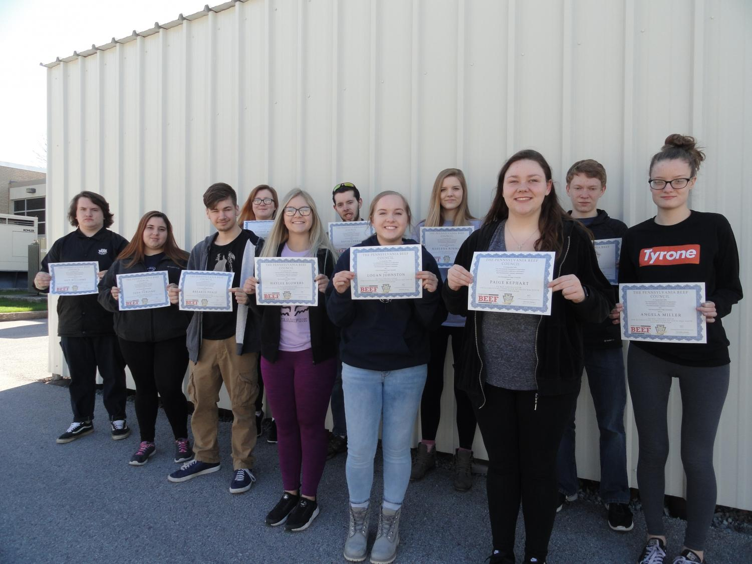 left to right – Guy Williams, Jada Turiano, Breckin Peale, Haylee Blowers, Logan Johnston, Paige Kephart, and Angela Miller; back row left to right – Allison Miller, David Conard, Marlyna Borman, and Zach Neff (not pictured: Kassy Kustenbauder)