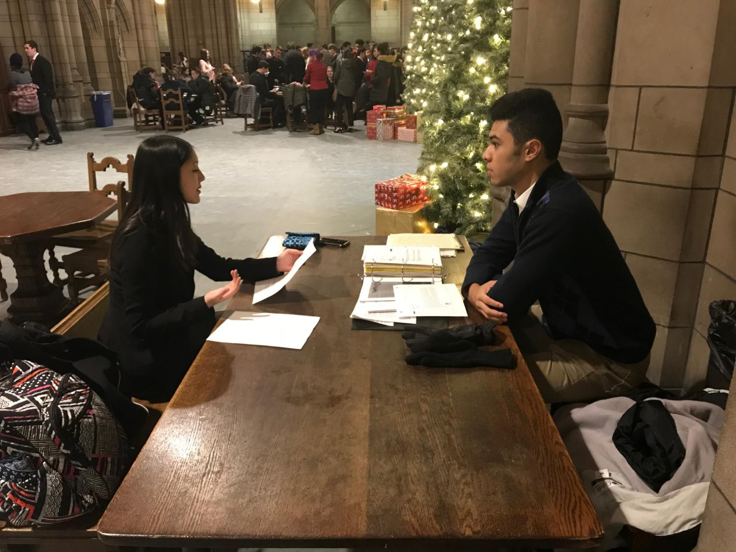 Junior Brandon Escala (right) prepares for a mock trial competition with senior Molly Harris  (right) at the annual Pitt Mock Trial Invitational in Pittsburgh