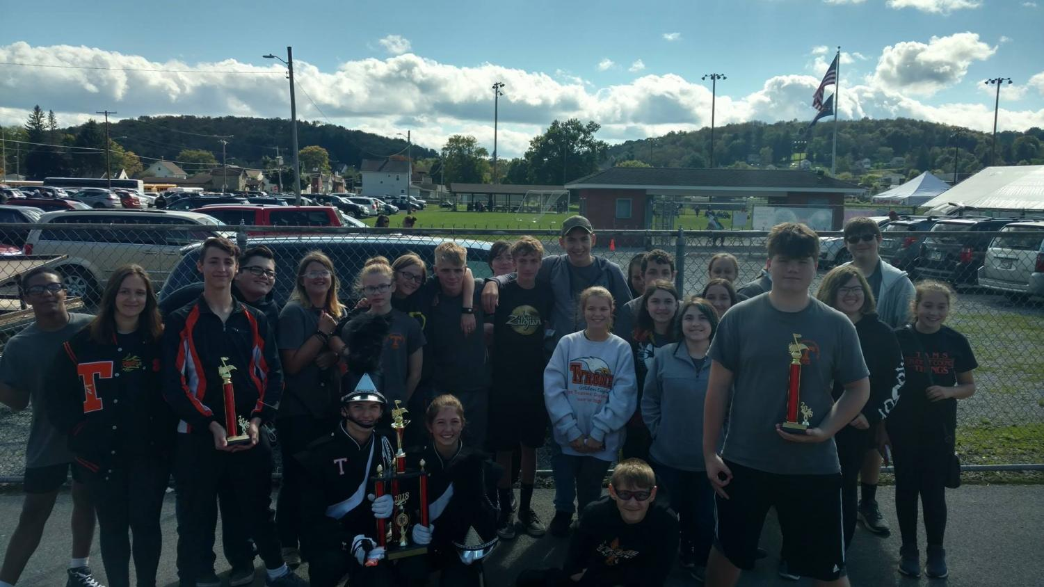 The band with their first place trophy