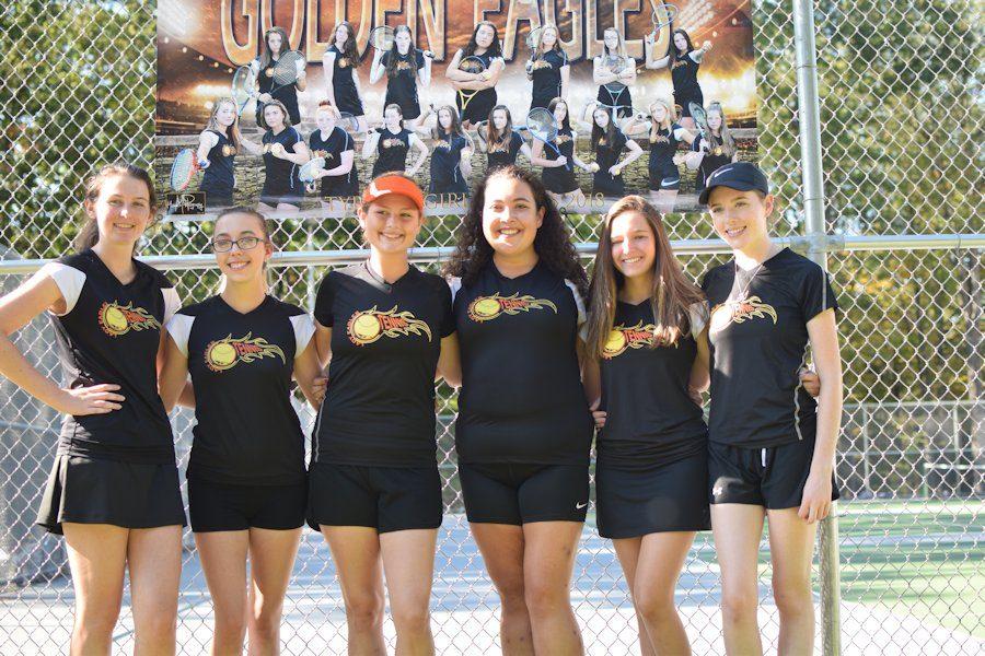 Tennis seniors Haley Conrad, Heather Osterhout, Megan Tepsic, Hannah Gampe, Alivia Jacobs, and Ava McCracken