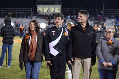 Ethan White and his parents on senior night.