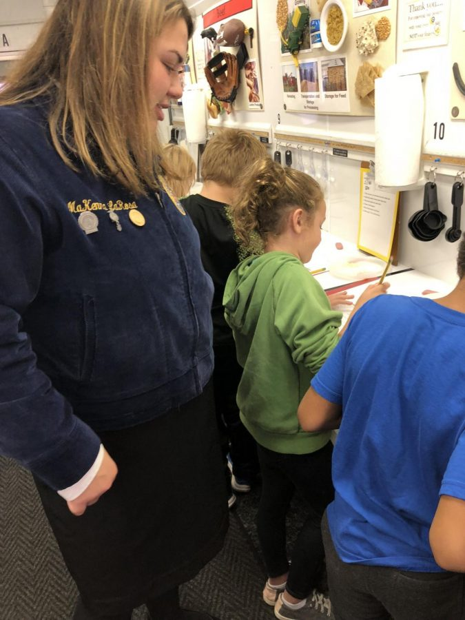FFA member MaKenna LaRosa works with the students