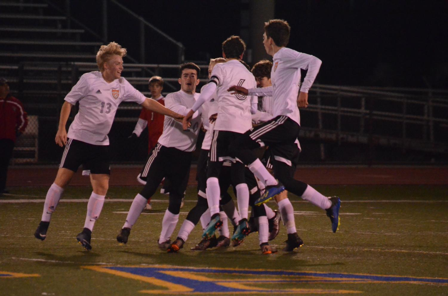 The team celebrates their playoff win vs. Hollidaysburg