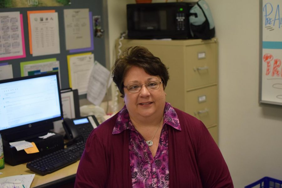 Business+teacher+Ms.+Jane+Bugden+at+her+desk+in+room+125.+Budgen+is+in+her+second+year+at+Tyrone+High+School.