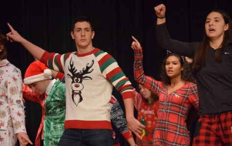 Sophomore Dean Grassi performs with musical group Pops Extension at the 2018 Christmas Assembly.
