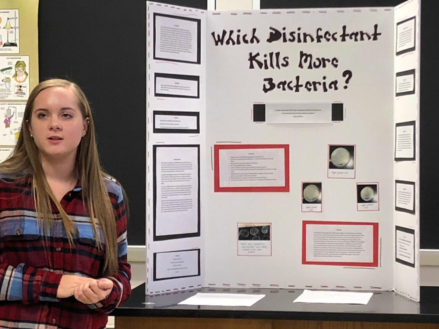Logan Johnson presenting her project to the judges.  Each project is judged by nine different judges.
