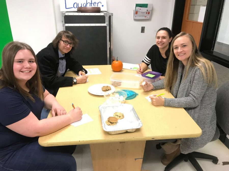 Eagle Eye staff judges (l-r) Emma Hoover, Haydn Loudenslager, Grace LeGars, and Ava Focht eating and grading entries on the first day of the cookie contest.