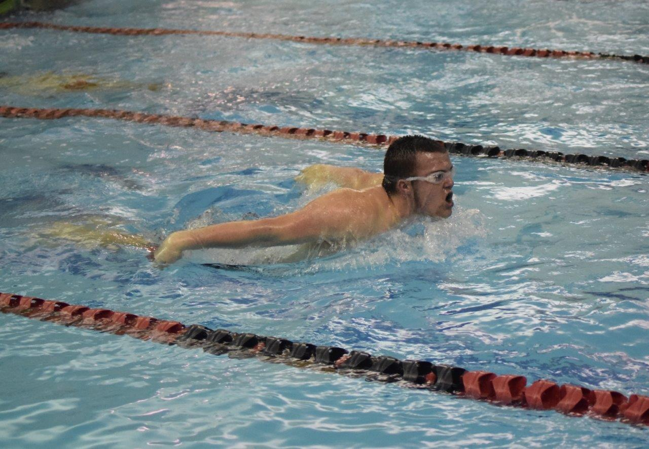 Carter Maceno swimming butterfly stroke in the 200M Medley Relay.