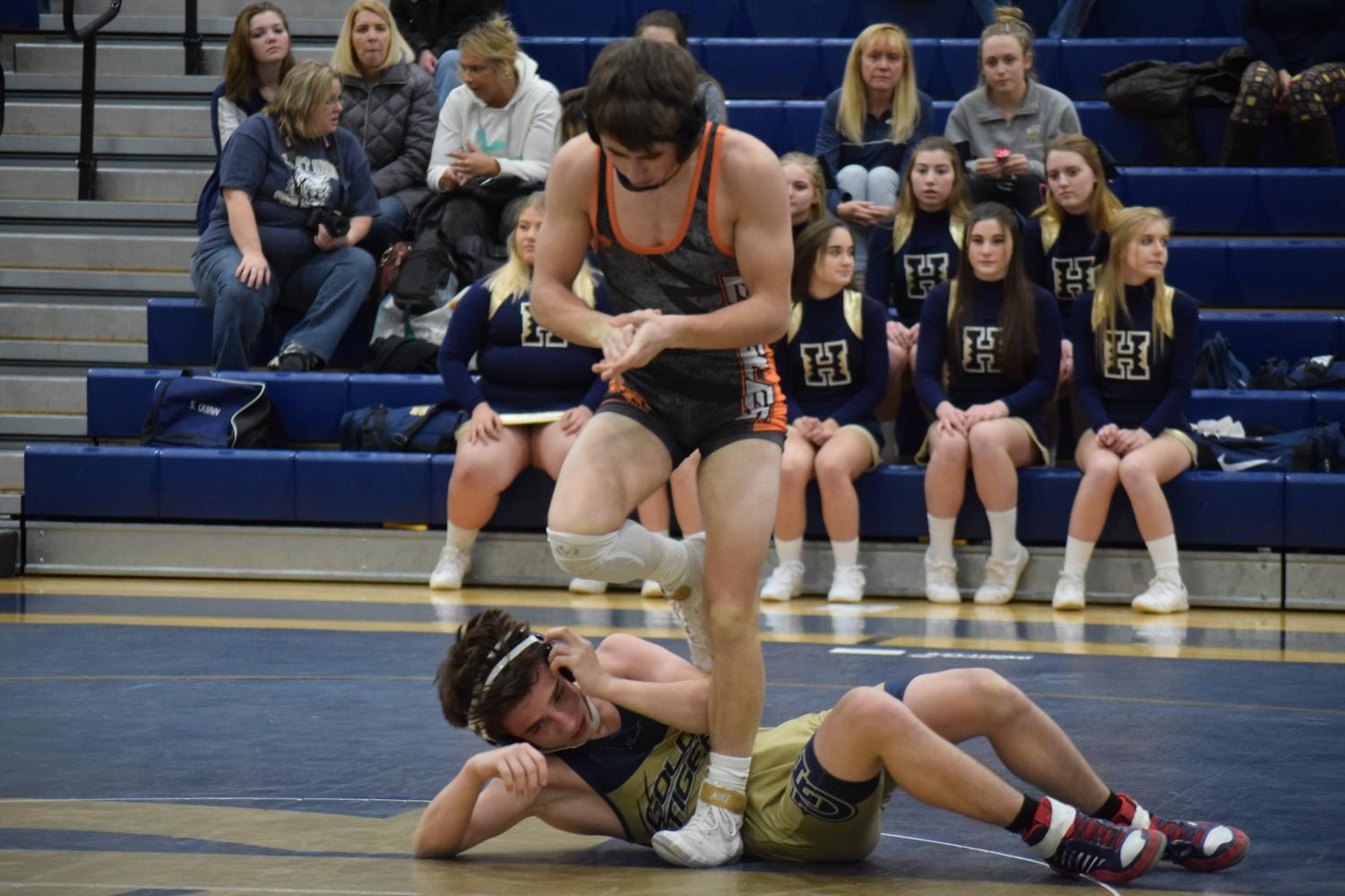 Tyrone sophomore Hunter Walk dusts himself off after another pin.