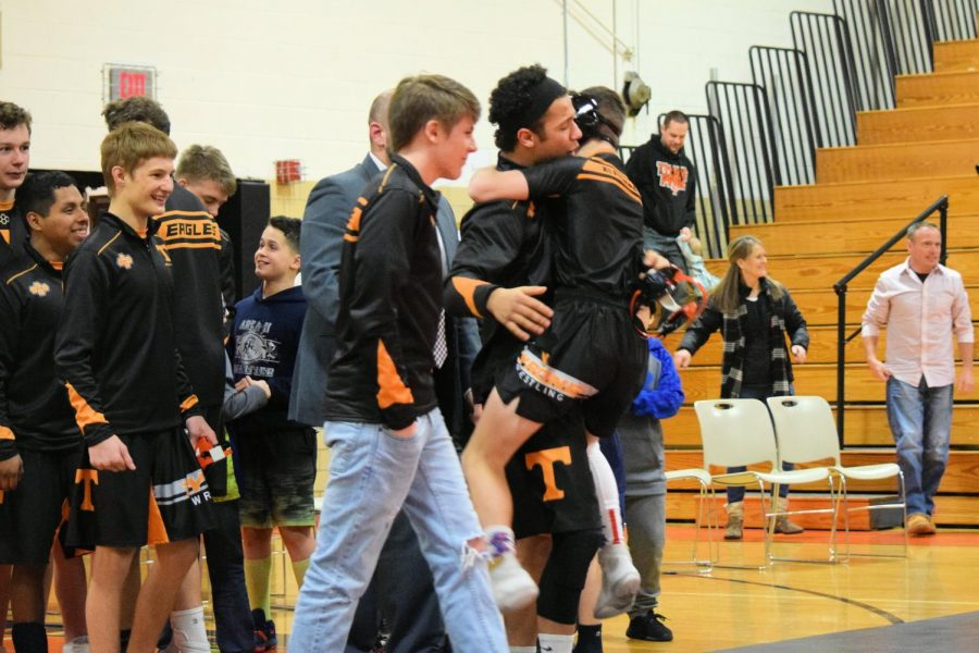 Sophomore Hunter Walk jumps into sophomore Tommy Hicks arms following the win over Bellwood.