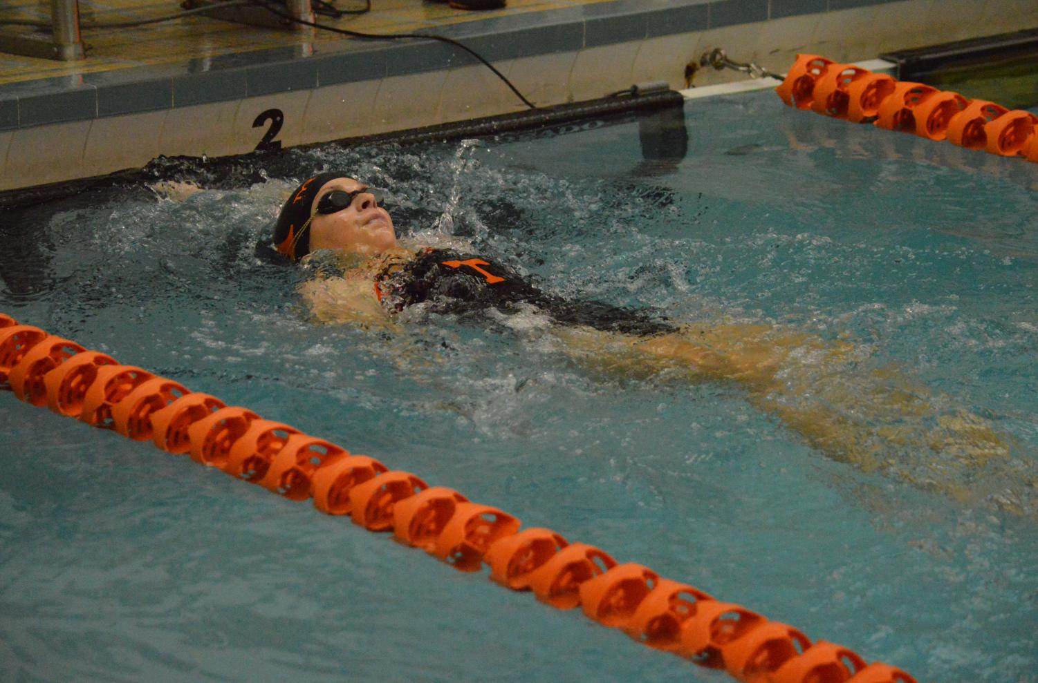 Cate Baran finishing the 100 backstroke