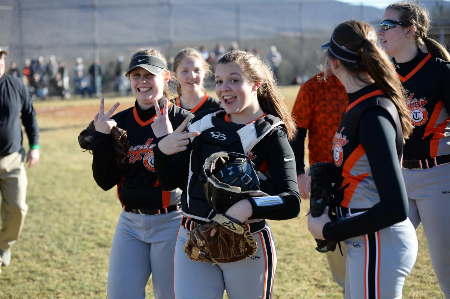 Juniors, Ally Jones and Callie Maceno throwing up peace signs in between innings.