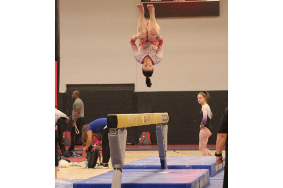 Olivia Barr competing on beam