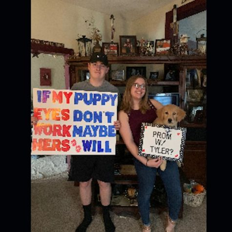 Anna Beck and Tyler Gunsallus with their promposal and their puppy.