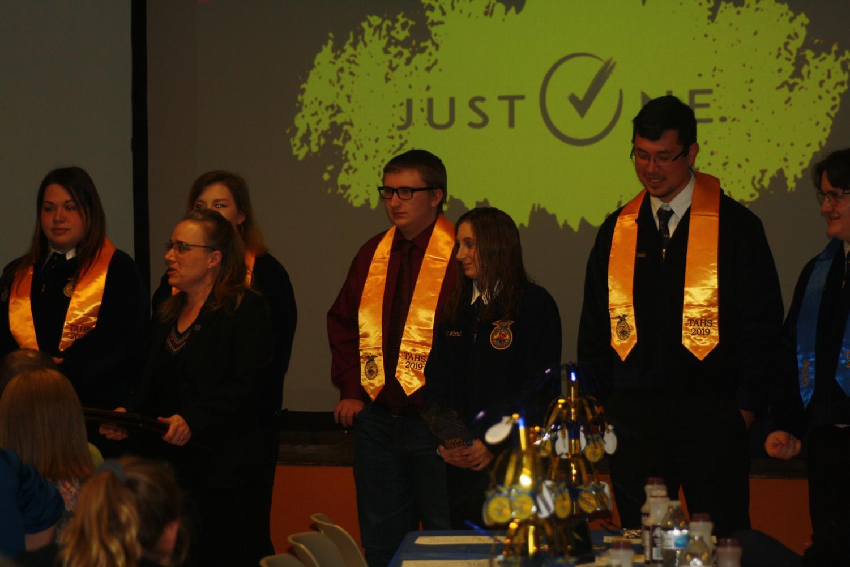 The following seniors receiving their sashes.