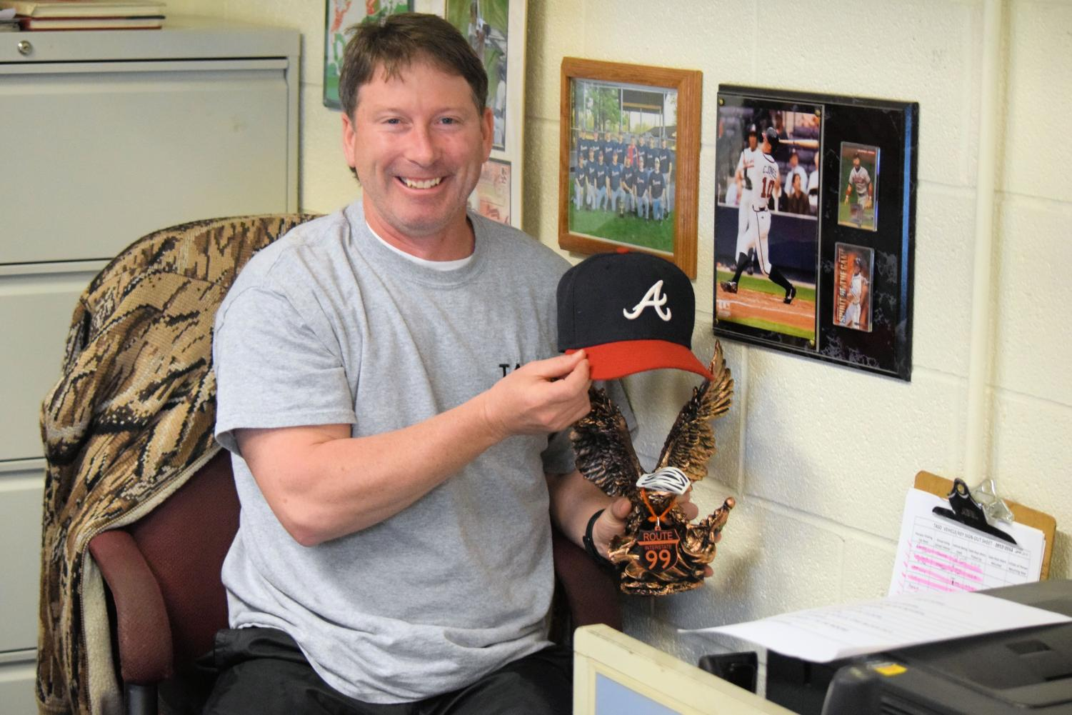 Jimmy Coleman shows off some of his favorite Atlanta Braves items in his office