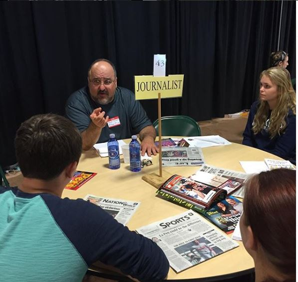 Students from Tyrone and all over Blair County met with representatives of many different career paths at the 2019 Career Fair.  Students here learn about journalism from Altoona Mirror employees (file photo).