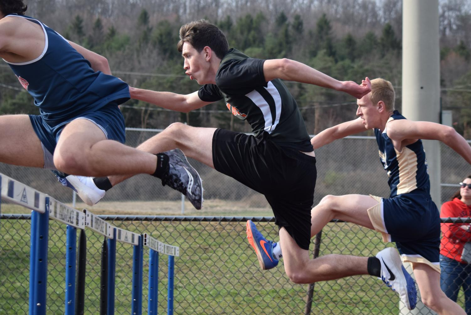 Nathan Walk competing in hurdles against Bald Eagle