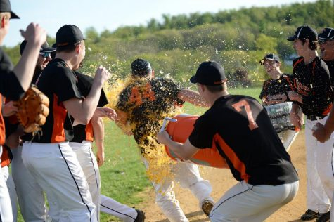 Matthew Savino giving Coach Kevin Sollener a Gatorade Shower
