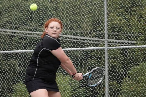 Lydia Irvin goes for a backhand to win the match.