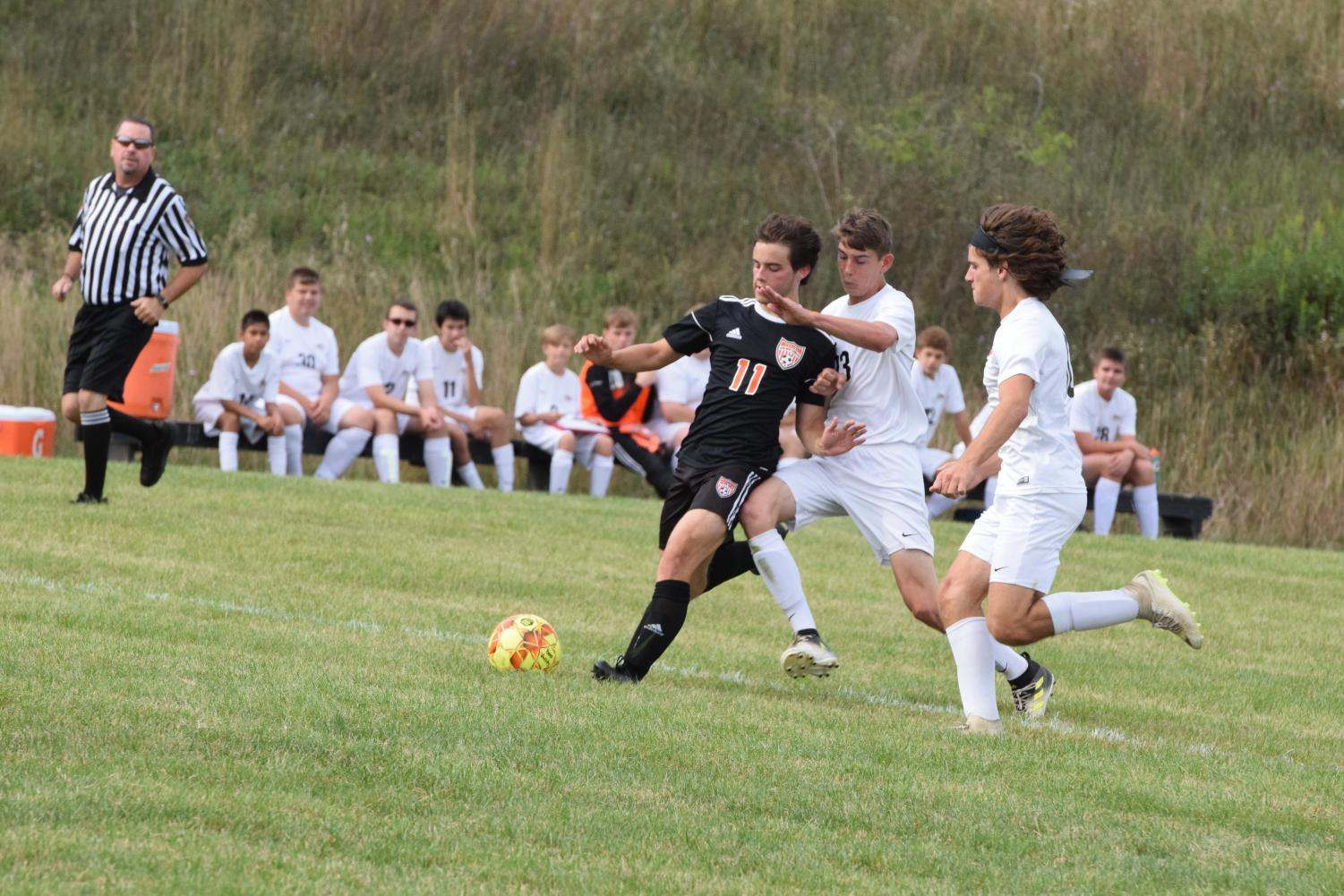Daniel Parker taking a contested shot on goal.