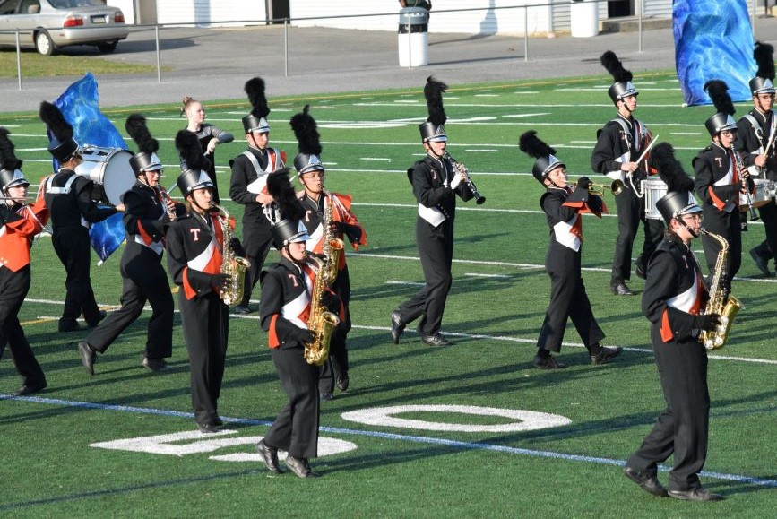 The+TAHS+marching+band+brass+and+wood+wind+section+performing.