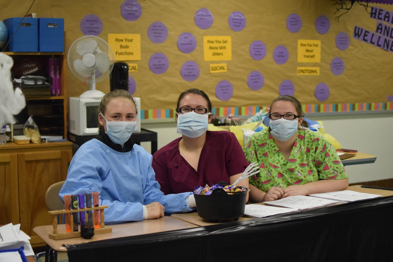 Sarah Hoover, Maddie Diebold, and Jadyn Waite, all members of Tyrone High School HOSA Club volunteered at last year's YAN Halloween Event.