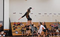 Outside hitter Reagan Irons preparing for a hit.