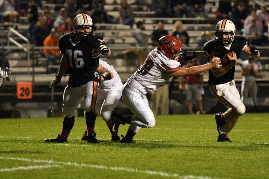 Brandon Lucas tries to avoid Bellefonte tackler